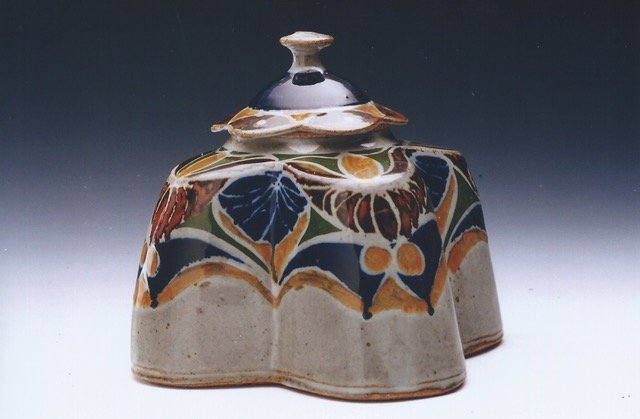 decorated hand built covered jar paint fire and glaze